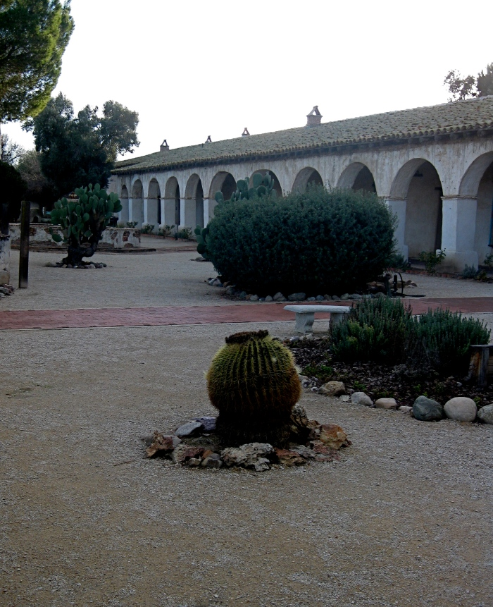 Arcade and grounds at San Miguel