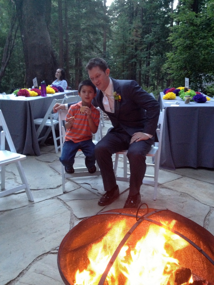 Ryan (the Groom) imparts s'more skills to a new generation